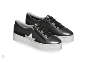 black trainers with star applique